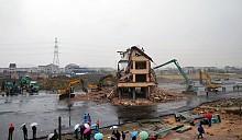 Китайский дом посреди дороги был снесен